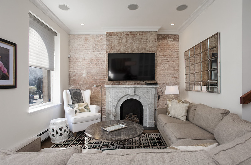 A TV wall design with bricks