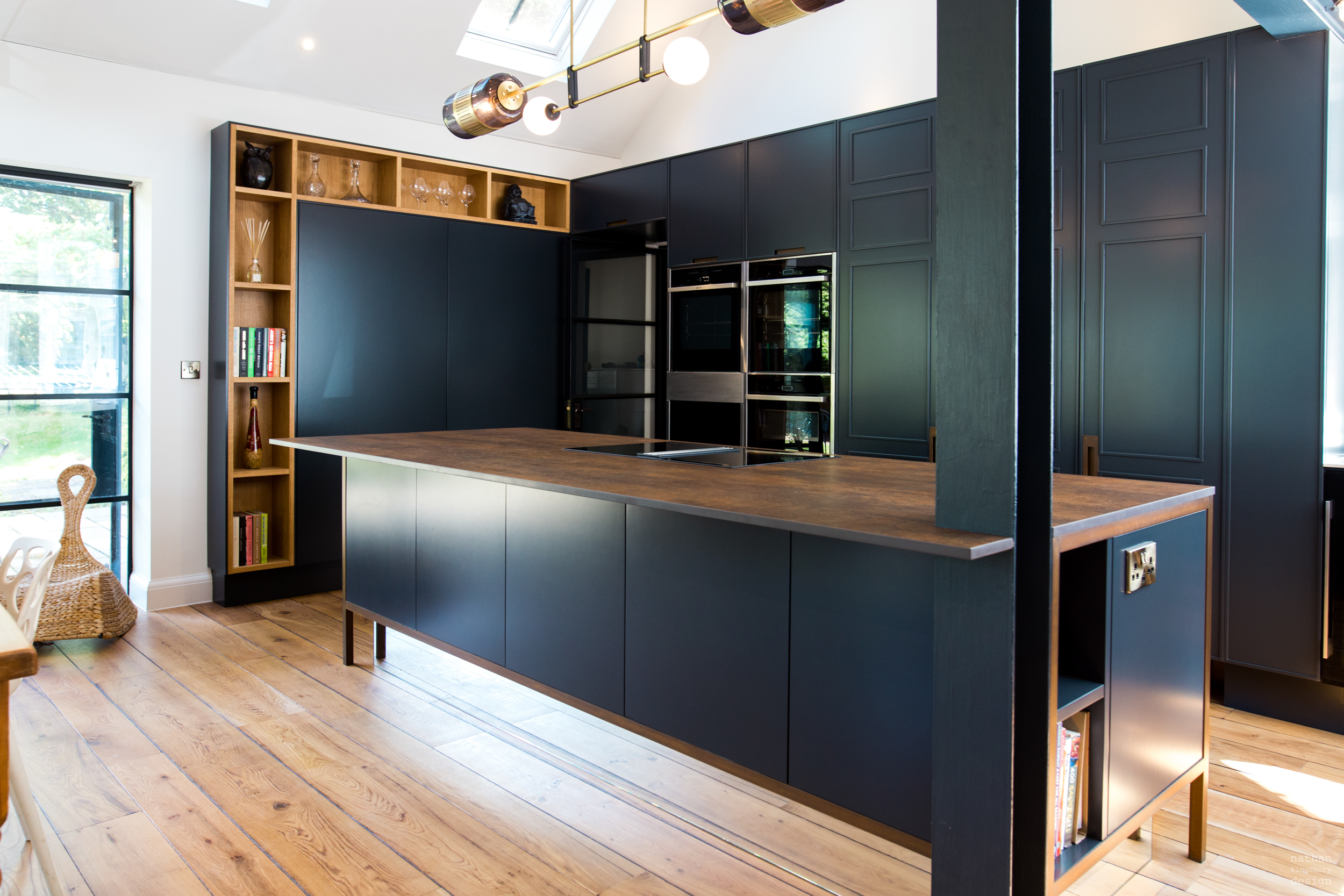 Simple black kitchen with wood
