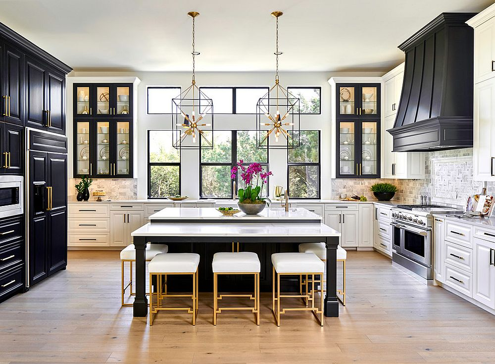 An eclectic black kitchen with golden accessories