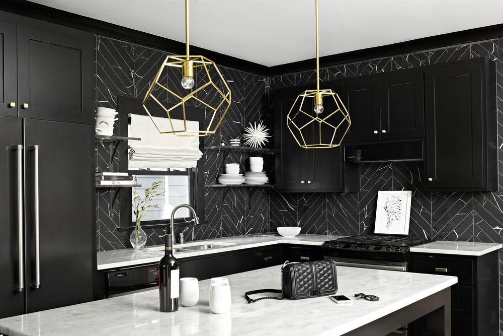 Black kitchen golden lamps