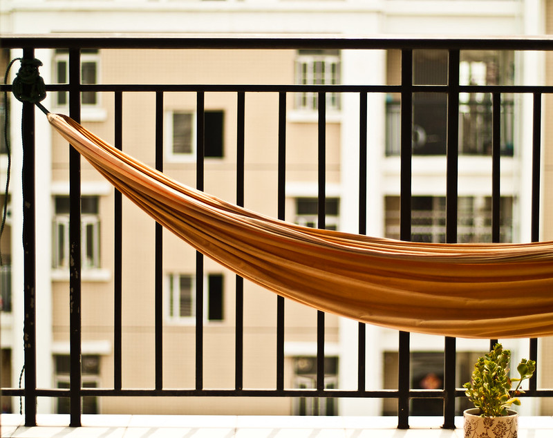 A hammock on a small balcony